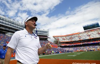 University of Florida head coach Dan Mullen walks on the field before the Florida Gators game against Tennessee in 2019- Florida Gators football- 1280x873