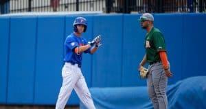 University of Florida second baseman Cory Acton looks towards the dugout after a single against Miami- Florida Gators baseball- 1280x853