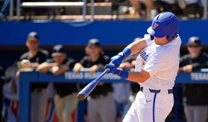 University of Florida catcher Nathan Hickey gets a hit as the Florida Gators beat Troy to complete a series sweep- Florida Gators baseball- 1280x853