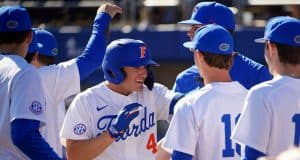 University of Florida outfielder Jud Fabian is greeted after a three-run home run against Troy- Florida Gators baseball-1280x853
