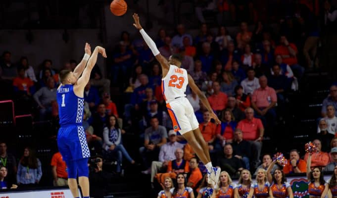 University of Florida freshman Scottie Lewis goes up for a block in a loss to the Kentucky Wildcats- Florida Gators basketball- 1820x853