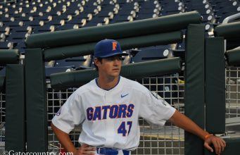 University of Florida pitcher Tommy Mace relaxes before the Florida Gators game against Texas Tech in the 2018 College World Series- Florida Gators baseball- 1280x850