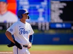 University of Florida sophomore Jud Fabian stands on third base after a triple against Troy- Florida Gators baseball- 1280x853