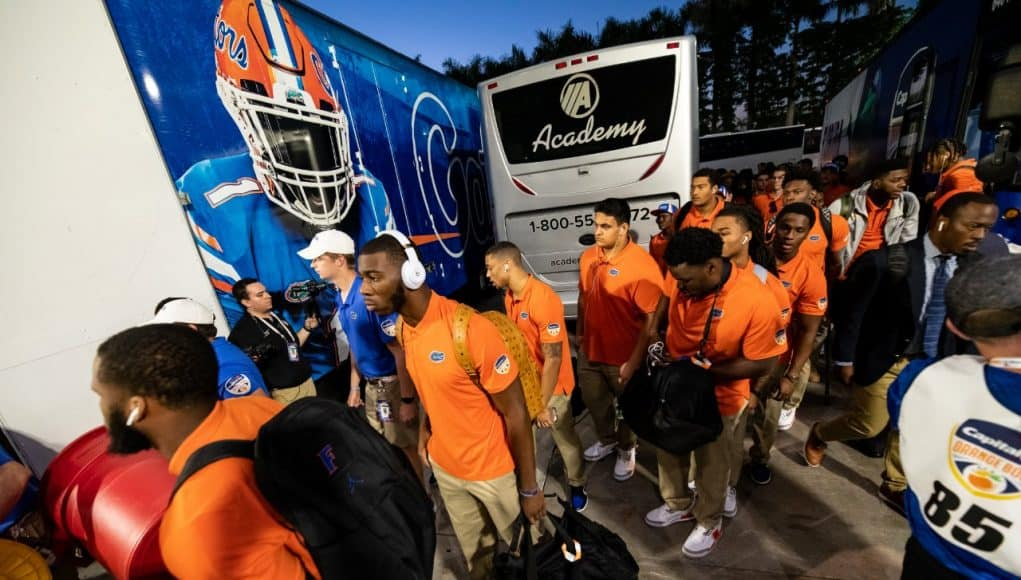 The Florida Gators get off the bus and enter Hard Rock Stadium before their Orange Bowl matchup against Virginia- Florida Gators football- 1280x853