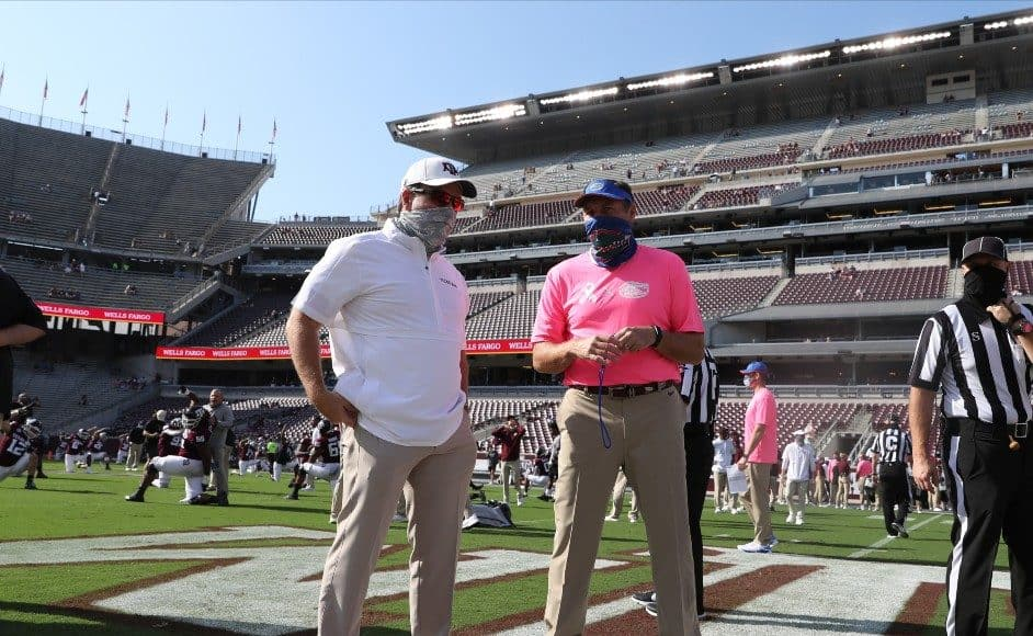 Dan Mullen talks with Jimbo Fisher before the A&M game- 942x700