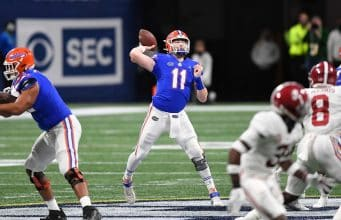 Quarterback Kyle Trask throws against Alabama in the SEC Championship- 1150x767