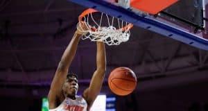 Omar Payne throws down a dunk against Kentucky in 2020 - 1280x854