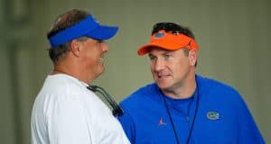 Dan Mullen and Todd Grantham have a discussion ahead of spring practice - 1280x854