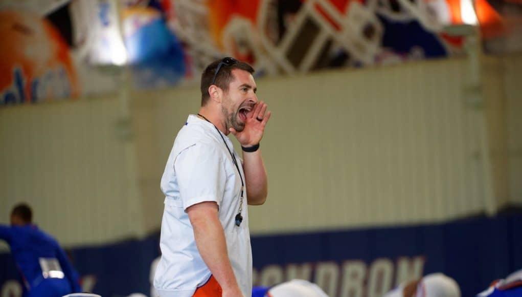 Florida Gators strength coach Nick Savage during team warmups at a 2019 spring practice - 1280x853