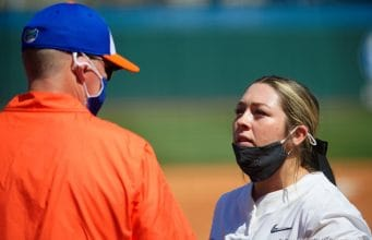 Florida Gators head coach Tim Walton has a chat with pitcher Natalie Lugo in the circle - 1280x854