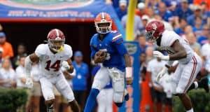 Florida Gators quarterback Emory Jones runs against Alabama in the Swamp-1280x854